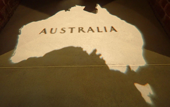 A reflected map of Australia with the word 'Australia' in capital letters